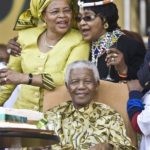 188. Former President Nelson Mandela with his wife, Graca Machel and former wife, Winnie Madikizela Mandela (Gallo Images)