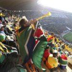 197.  Flag-draped  fan blowing vuvuzela (Gallo Images)