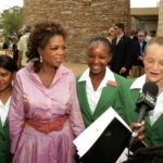 211.  Oprah Winfrey with some of the girls at her school in 2007 (GettyImages)
