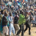 220.  Striking miners at Marikana led by the man in the green blanket (Times Media)