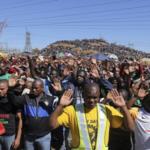 222.  Miners praying at Marikana a year later (Gallo Images)