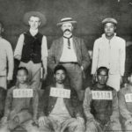 73. Numbered  Chinese workers with two white officials in 1904 (MuseumAfrica)