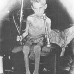 88.  Emaciated boy in one of the concentration camps (The War Museum, Bloemfontein)